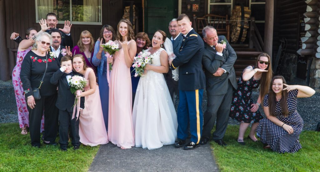 photo of bride and groom and family in silly poses