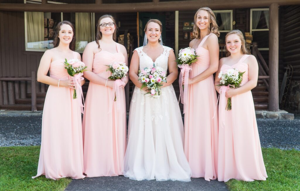 photo of bride and bridesmaids holding bouquets of flowers