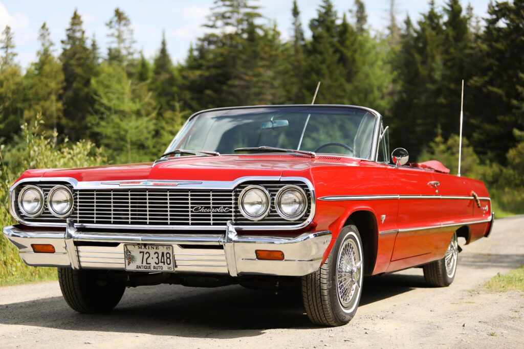 photo of red antique chevrolet car