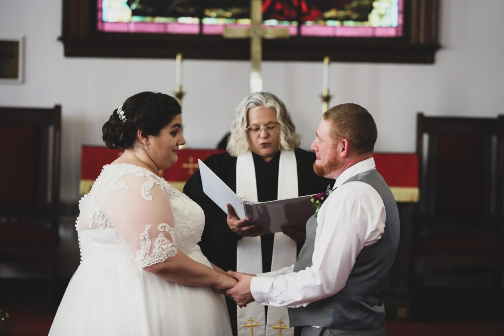 photo of bride and groom in church during wedding ceremony