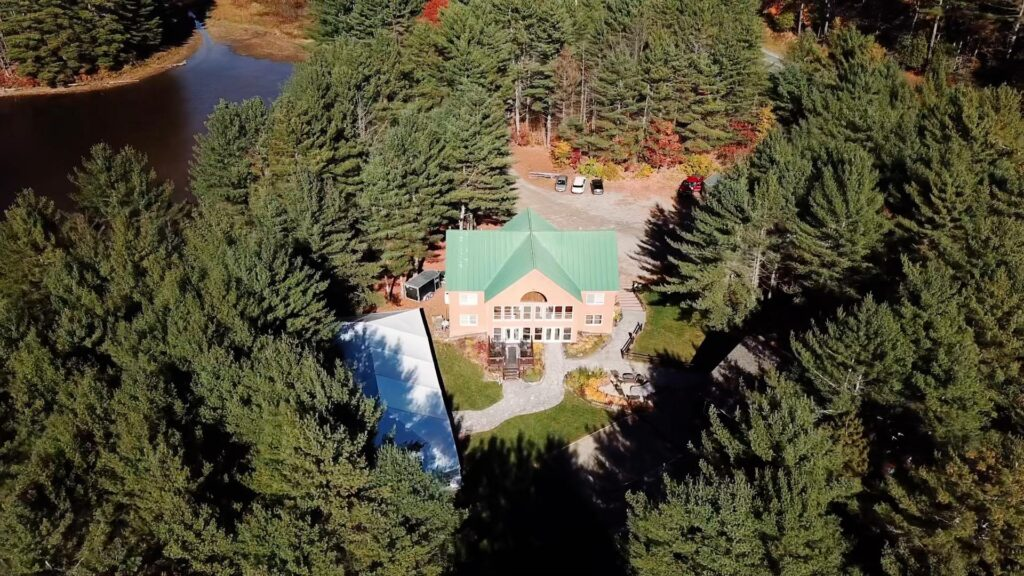 aerial drone photo of wedding venue surrounded by forest