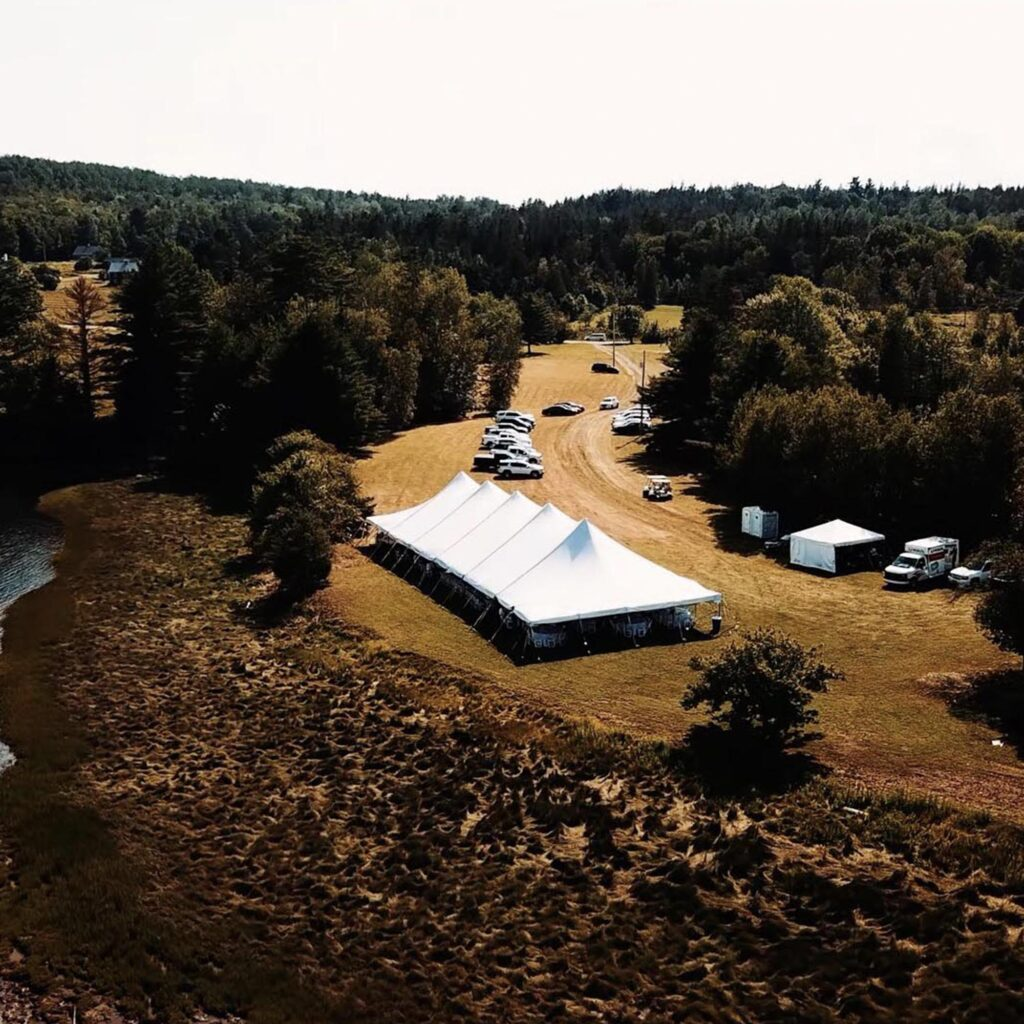 aerial drone photo of wedding reception tent in field
