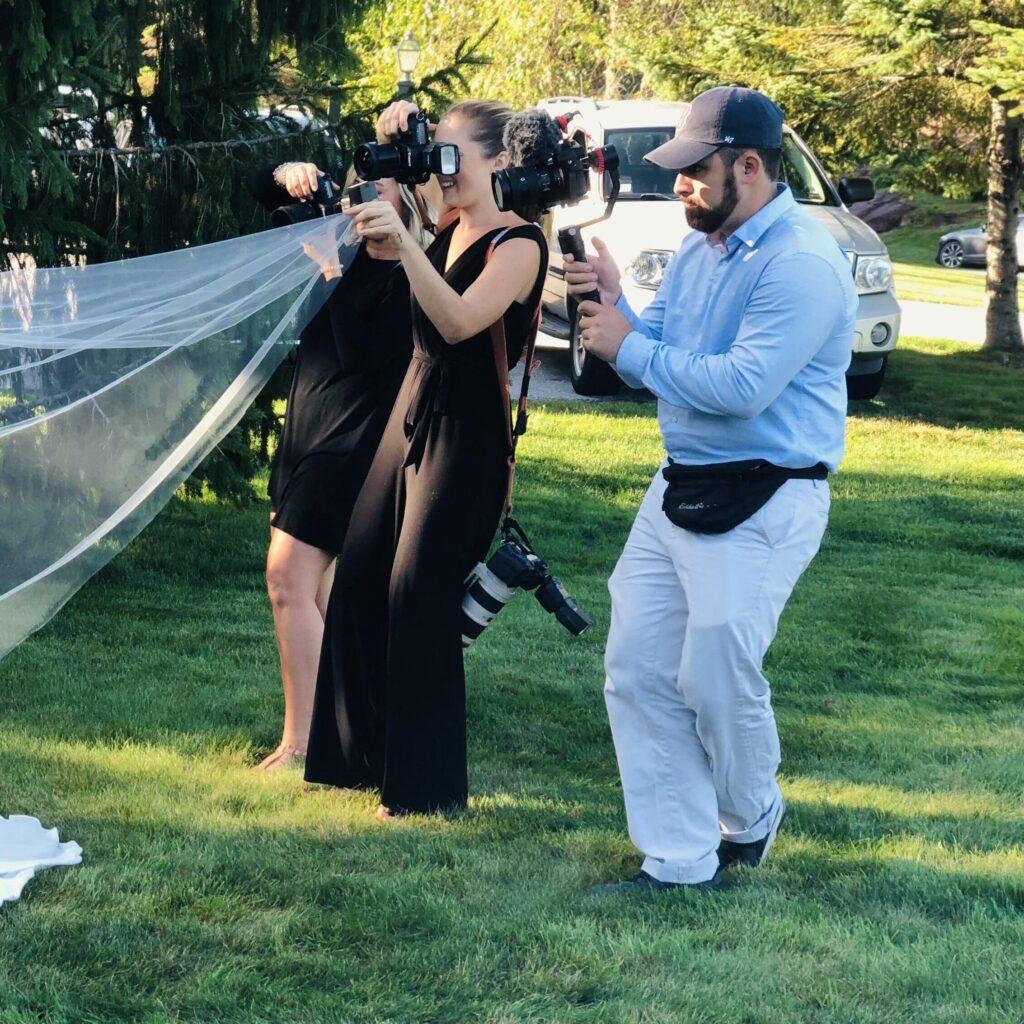 photo of photographers taking photos of bride