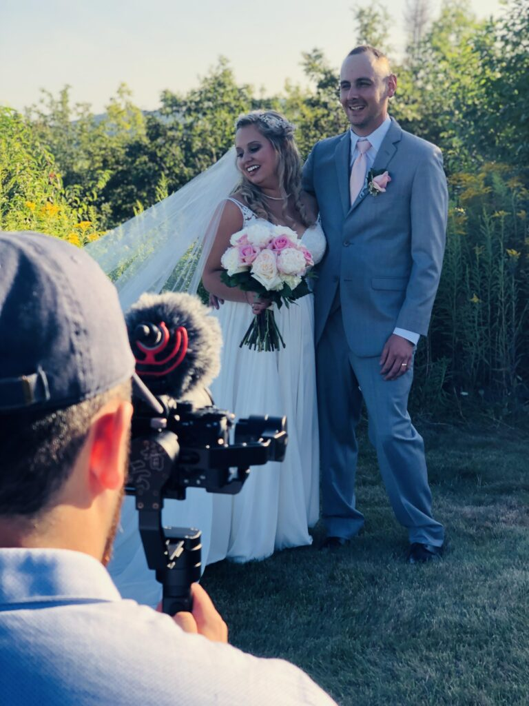 photo of photographer taking a photo of a bride and groom