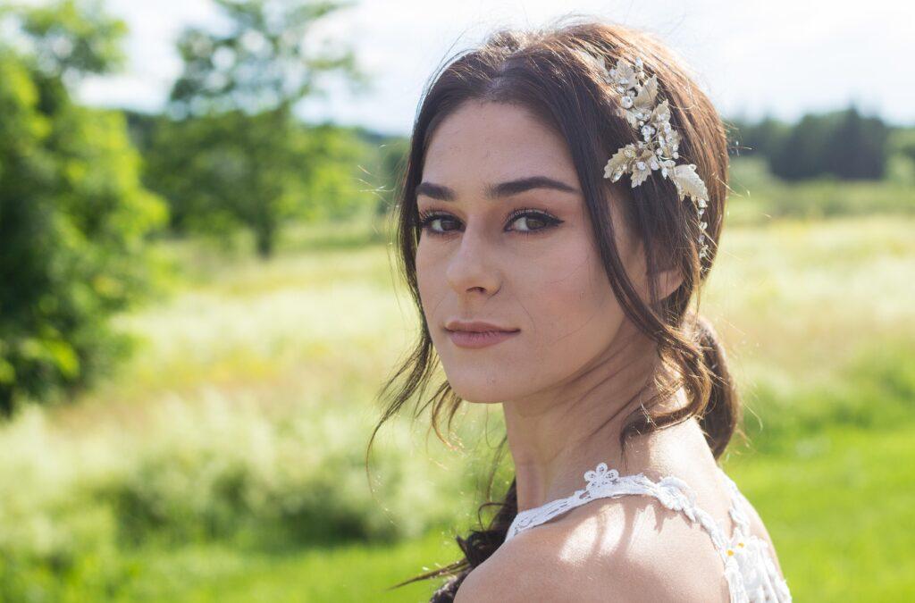 photo headshot of bride outside in field