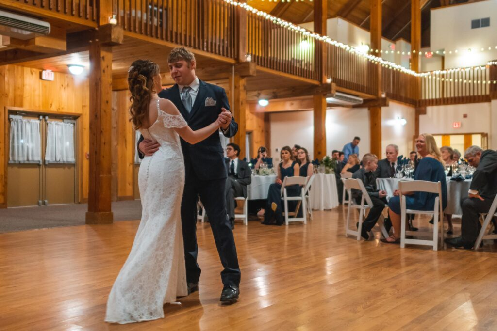 photo of bride and groom dancing their first dance at reception