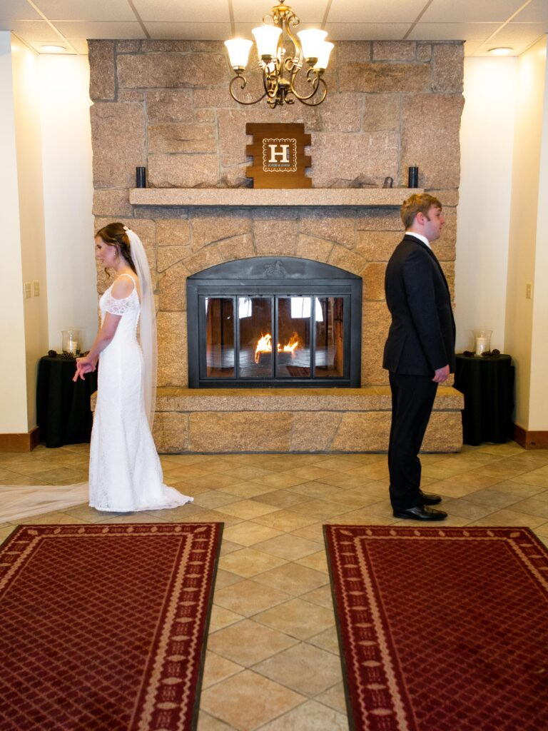 photo of bride and groom facing away from each other