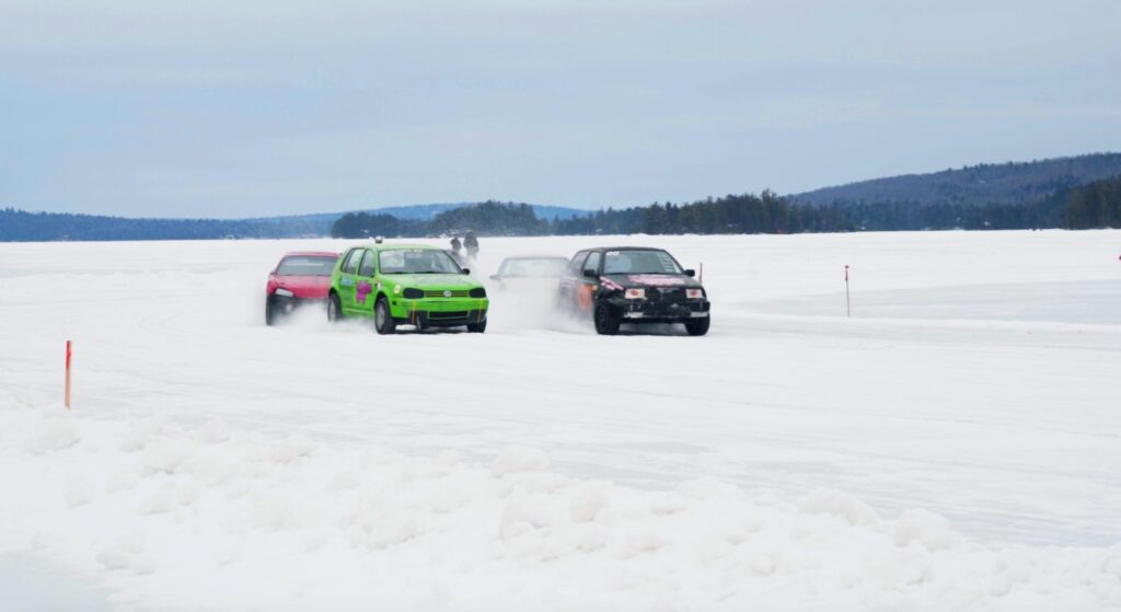 photo of cars racing in the snow